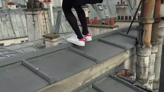 Parisian rooftop acrobat